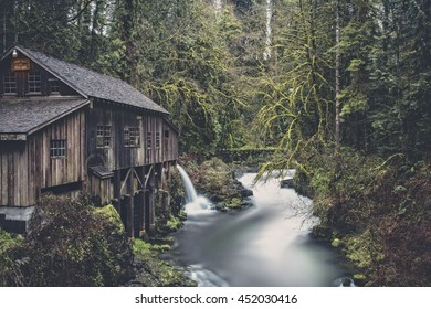Long exposure of water flowing into stream from Cedar Creek Grist Mill in Washington State, USA.