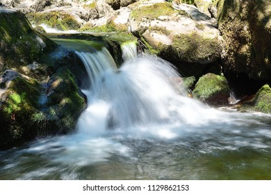 long exposure of a waterfall at Aira force waterfall park in the Lake district in Cumbria