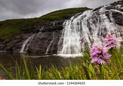 Long exposure of a waterfall in Vestmanna, Faroe Islands, Denmark.