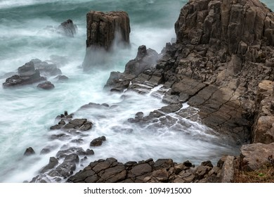 Long exposure of waves hitting the sea shore. Tojinbo Cliff, Fukui prefecture, japan