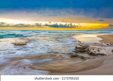 Long exposure of the waves at the sea shore at sunset