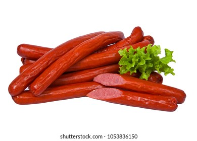 Long and fatty sausages with salad leaf. Meat product whole and partially sliced. Isolated on white background
