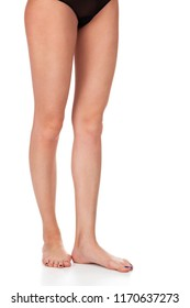 Long female legs isolated on white background