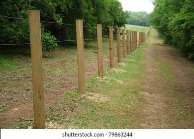 long fence of wooden posts and wire