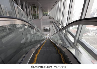 Long Generic Escalators in Public Library Going Up or Down