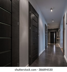 Long and gray corridor in luxury house
