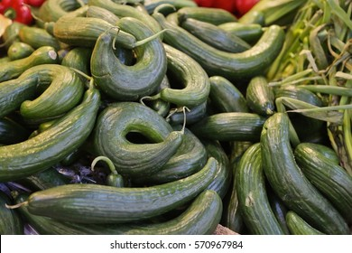 long green cucumbers on a counter in the market in the center of Budapest