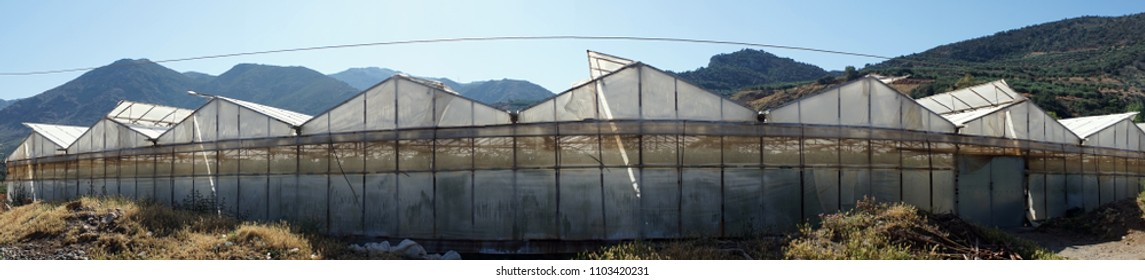 Long greenhouse on the Sfinari beach in Crete island, Greece
