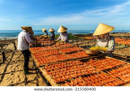 long hai vietnam workers dry fish stock photo edit now 215580400