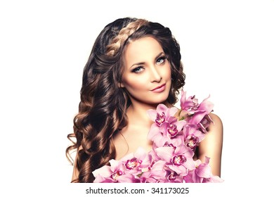 Long hair. Waves Curls Hairstyle. Hair Salon. Updo. Fashion model with shiny hair. Woman with healthy hair girl with luxurious haircut. Hair loss Woman with hair volume.