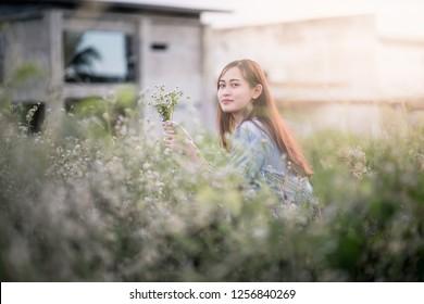 long hair woman in flower field
