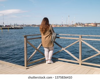 Long hair woman looking at the gulf at Stockholm