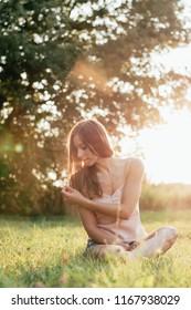 Long hair woman at sunset