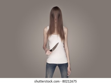 long haired woman holding a knife