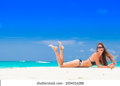 long haired woman in swimsuit at beach