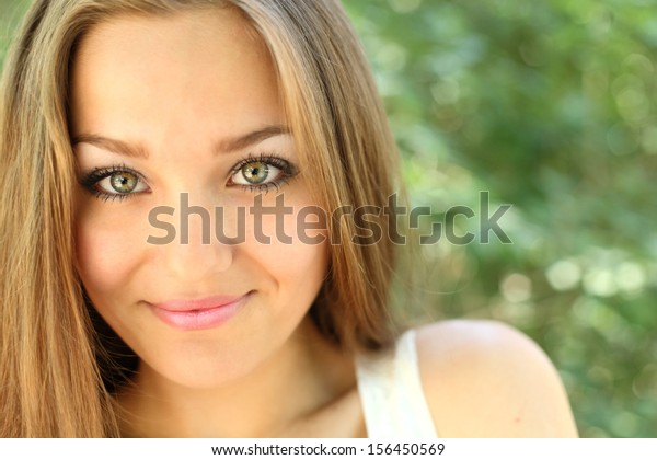 long haired women outdoors enjoy summer, closeup of the face, headshot, smiling