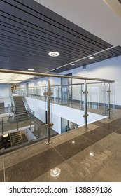 Long hall of a modern office with glass banister