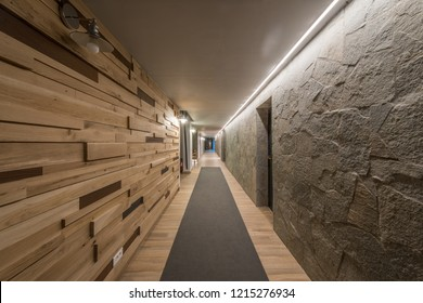 Long hallway and ceiling in modern hotel