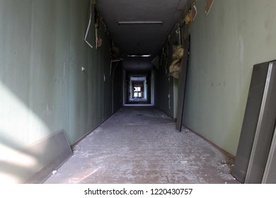 A long hallway in an unused, ruined building which was occupied by Separatists in the ongoing Ukrainian Civil War.