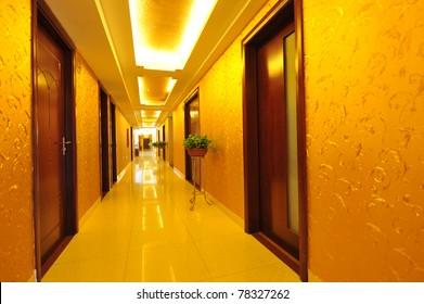 long hotel corridor with light,nobody.