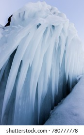 Long icicles and ice on the rocks, Lake Baikal (Russia)