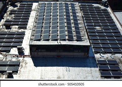 LONG ISLAND CITY, NY - OCTOBER 13, 2016: Over one hundred Solar Panels cover the roof of Petrossian Inc., produce wholesaler. Solar Panels take in energy from the Sun and convert  it to Electricity.