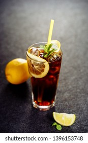 Long Island Cocktail with Cool Vodka Cola Drink. Ice Tea and Rum in Glass on Dark Background. Longdrink Alcohol Soda Brown Beverage. Cuba Libre Party Liquor Closeup. Summer Pepsi Refreshing Lemonade