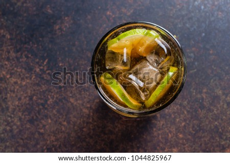 Long Island With Ice And Lime On Background Table. Iced Tea Cocktail With  Strong Drinks
