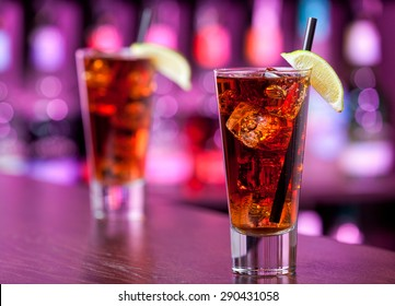 Long island iced tea cocktail shot on a bar counter