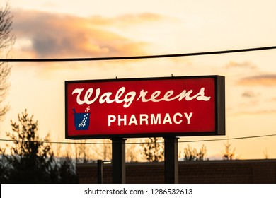 Long Island, New York : January 16, 2019 : Walgreens Pharmacy sign lit up as flu season is in full swing.