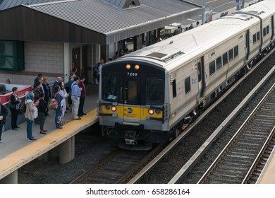Long Island, NY - Circa 2017: Long Island Railroad LIRR train arrive local station platform to commute passengers travel Penn Station New York City