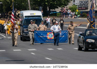Long Island, NY - Circa 2019: US military veterans march in memorial day celebrating during warm summer american holiday