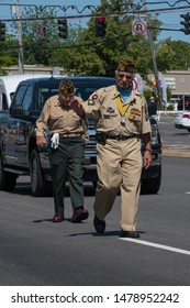 Long Island, NY - Circa 2019: United States veterans march in Memorial Day parade celebration to honor military men and women who have served country