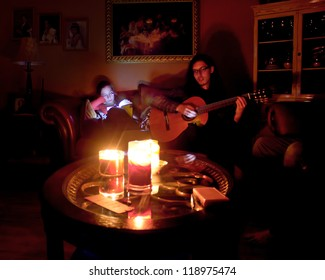 LONG ISLAND, NY- OCT 31: Couple in candlelit home due to Hurricane Sandy massive power outage in New York on Oct 31, 2012.  Sandy struck NY on Oct 29 leaving 1 million Long Islanders without power.