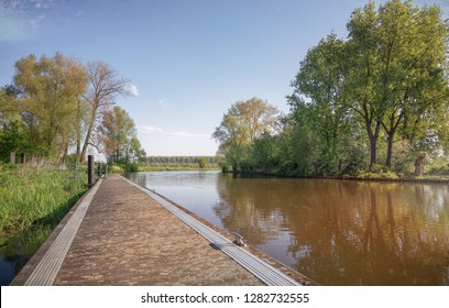 A long jetty along the river Linge in the Betuwe region in The Netherlands