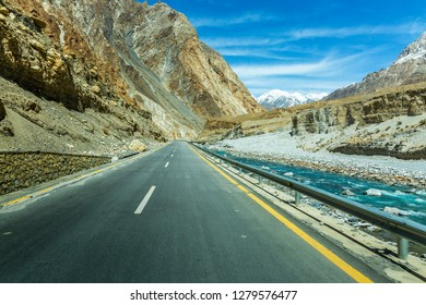 Long Karakorum Highway with river in Passu, Hunza district of Pakistan altitude 4500 m.