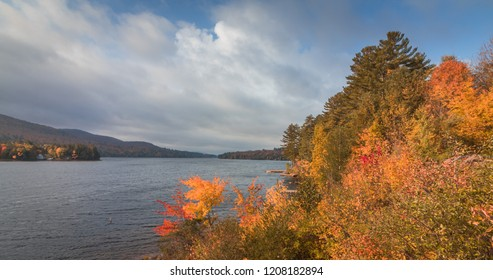 Long Lake, Adirondacks, NY, in the fall surrounded by colorful brilliant foliage