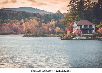 Long Lake, Adirondacks, NY, in the fall surrounded by brilliant colorful foliage