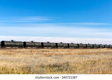 A long line of DOT-111 tank cars, commonly used in North America to transport crude oil to refineries along the coasts.