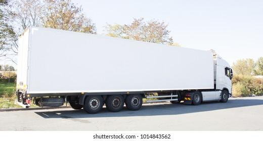 Long lorry with white truck and trailer