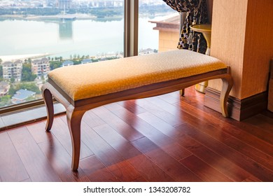 Long lounge chair near the window at a  new interiors, through the window a new Central Villa District by the river can be seen,Fuzhou,China