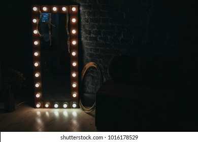 long mirror with lamps on floor in darkness