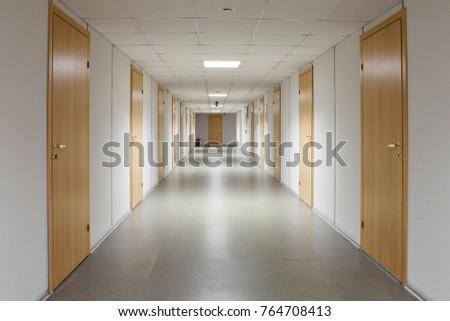 long office hallway yellow wooden doors stock photo edit now