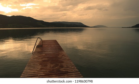 Long old wooden jetty deck background and beautiful sunset