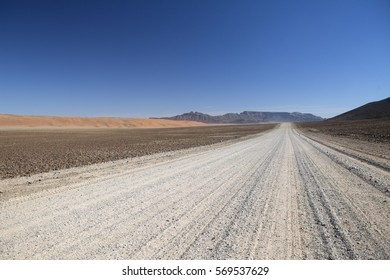 Long open gravel road in Namibia