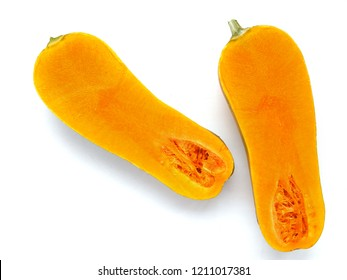 Long orange pumpkin in a cut, isolated on a white background, top view.