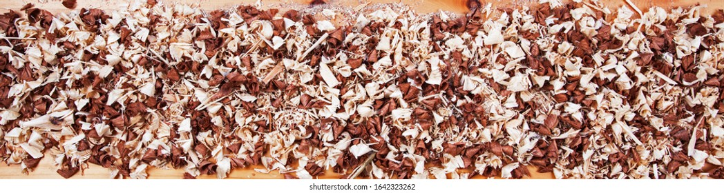 Long panorama of wood chip shavings for themes and concepts of DIY, natural designs, wood work, home improvment, building and making stuff - creative & inspirational background texture.