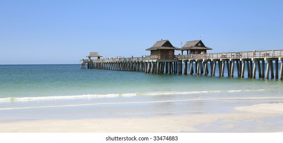 The long pier of caribbean beach of Naples in Florida - USA