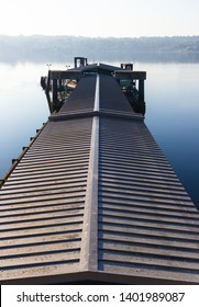 Long pier ceiling going in to the distance with water surrounding