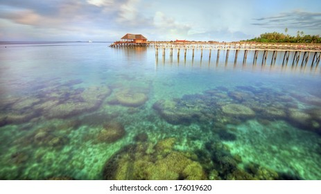 Long pier dan beautiful coral at Mabul Island. noise slightly visible due to long exposure and high iso